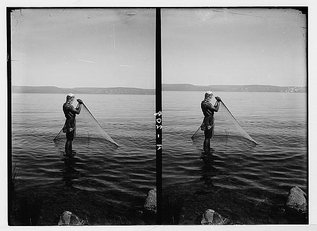 Northern views. Fisherman drawing in his net