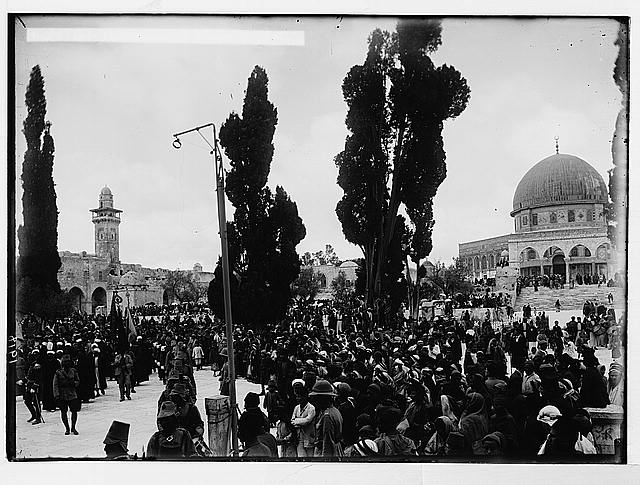 Costumes, characters, etc. Holy flags arriving at Mosque el-Aksa [i.e., al-Aqsa], [Nebi Musa procession]