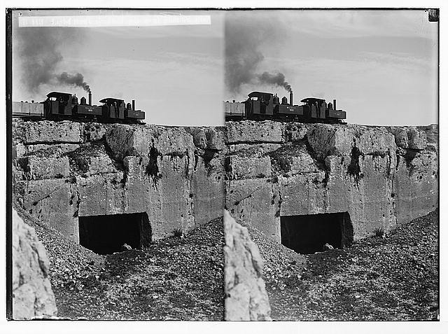 Various results of the war. Light railway crossing over ancient tombs.