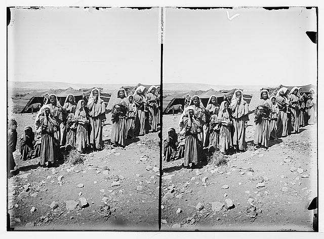 Bedouins watching women at encampments
