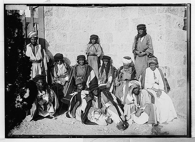 [Lepers seated in front of building]