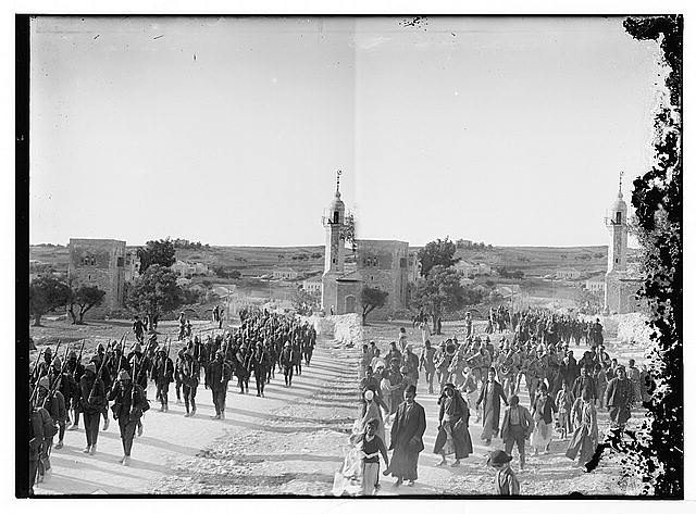 Turkish soldiers marching past Am. [i.e., American] Colony on Nablus Road [Jerusalem]; [Another view of Turkish soldiers on Nablus Road]