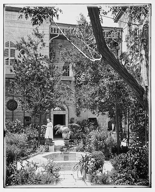 Mrs. Spafford in A.C. [i.e., American Colony] courtyard
