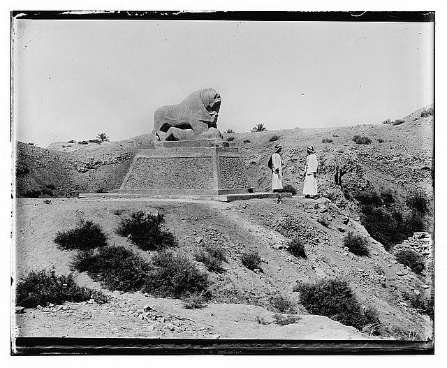 Iraq. Babylon. Basalt lion with figures