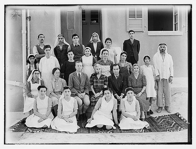 [Dr. C. MacLean, Ajlun. Gilead Mission Hospital. Group. Staff in front of entrance to women's ward]