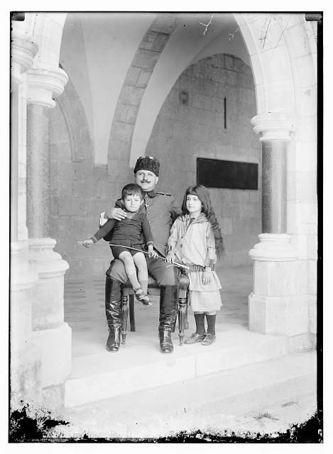 "[(""Kutchuk"") Jamal (Cemal) Pasha with two children, St. George's Cathedral, Jerusalem]"