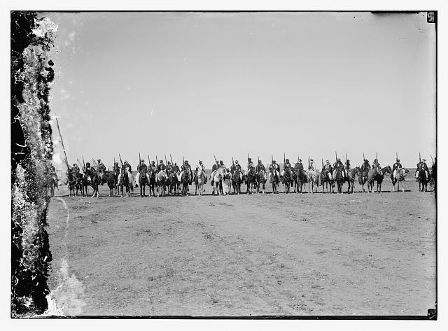 Line of mounted Bedouins, Pan Islamic conference escort of King Ali and Emir Abdullah