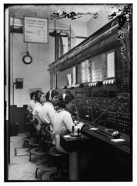 4 women at tel. [i.e., telephone] switchboard