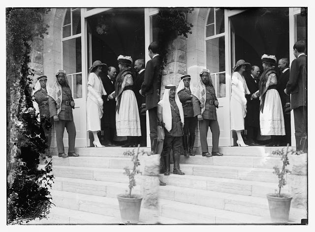 [Emir Abdullah (third from left) and Mr. and Mrs. Winston Churchill greeting Bertha and Frederick Vester in doorway, during reception at Government House, Jerusalem]