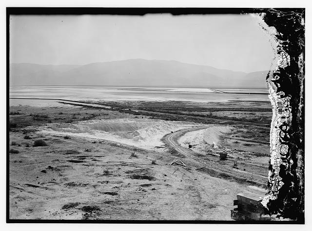 [Dead Sea album prepared for the Palestine Potash Ltd. Panorama in three sections from an upper floor from the factory showing south end of Jebel Usdum and the vast area of evaporating pans with dams & decauville tracks]