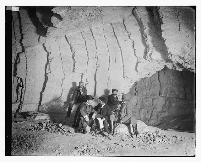 5 men seated in Solomon's Quarries