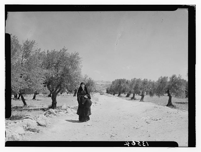 """Ruth"" story. ""Ruth"" carrying off wheat measured by ""Boaz"" (Sirvart). Pathway & trees in background"