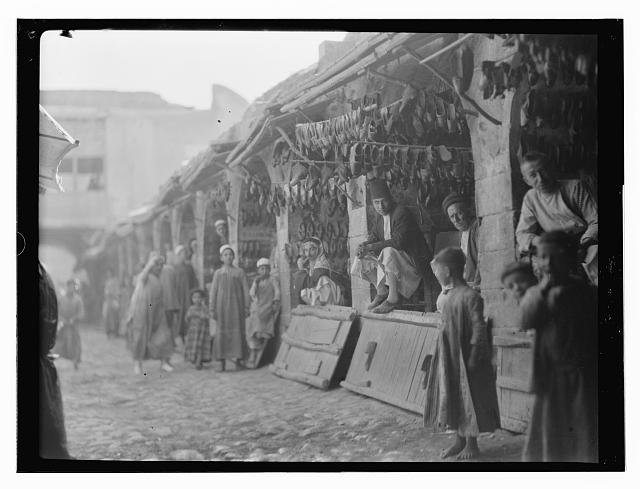 [Shoe sellers in market, Baghdad]