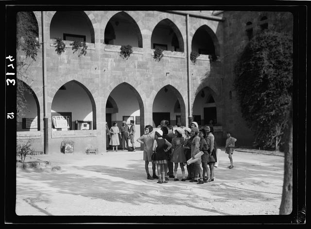 Zionist activities around Haifa. Haifa, a primary school. Using a picturesque old Arab bld'g [i.e., building]