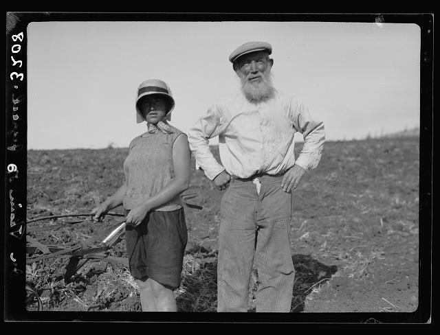 "The Keren Hayesod. Agricultural Colonies on Plain of Esdraelon ""The Emek."" Zionist agricultural zeal. Grandfather helping grand-daughter to plow"