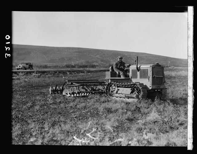 "The Keren Hayesod. Agricultural Colonies on Plain of Esdraelon ""The Emek."" Tractor disc plowing on the great stretches of Esdraelon"