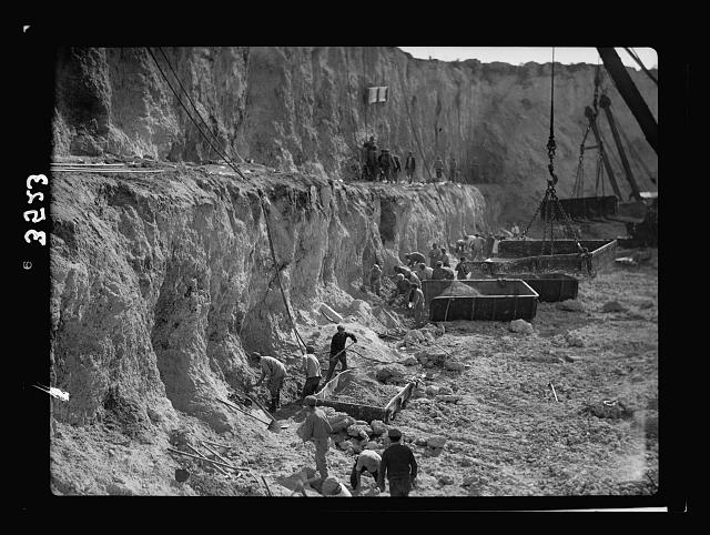 Construction of the Haifa harbour. The Athlit quarries. Loading R.R. [i.e., railroad] car skiffs
