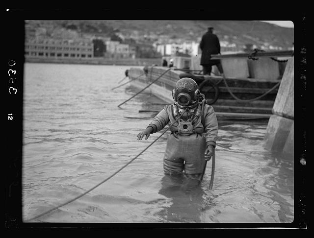 Construction of the Haifa harbour. Haifa harbour. Diver at work
