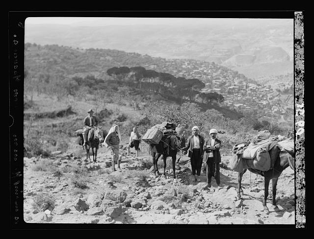 Mount Hermon and vicinity. Ascent to Hermon. Party and pack mules. Hasbeya in distance