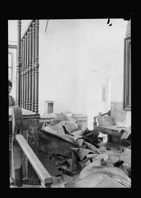 Palestine events. The 1929 riots, August 23 to 31. Synagogue desecrated by Arab rioters. Hebron. Large scroll in a jumbled heap on the floor