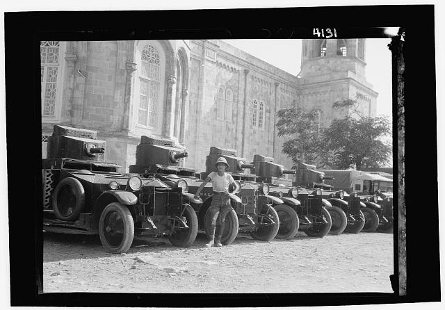 "Palestine events. The 1929 riots, August 23 to 31. British armoured cars ""standing to"" during the outbreak. At the Russian buildings"