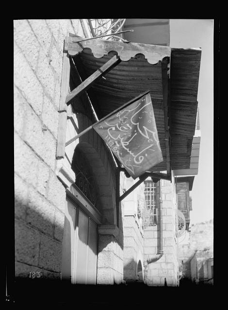 "Arab protest delegations, demonstrations and strikes against British policy in Palestine (subsequent to the foregoing disturbances [1929 riots]). Black flag inscribed ""Faltahya Falastin."" ""Long live Palestine."" Balfour Day"