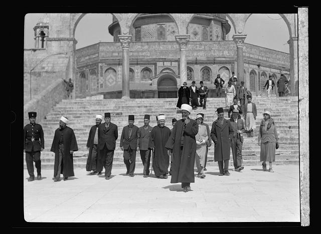 Visit of H.R.H. Princess Mary and the Earl of Harwood. March 1934. Princess Mary at the Dome of the Rock, Jerusalem. Escorted by the Grand Mufti and staff, March 13