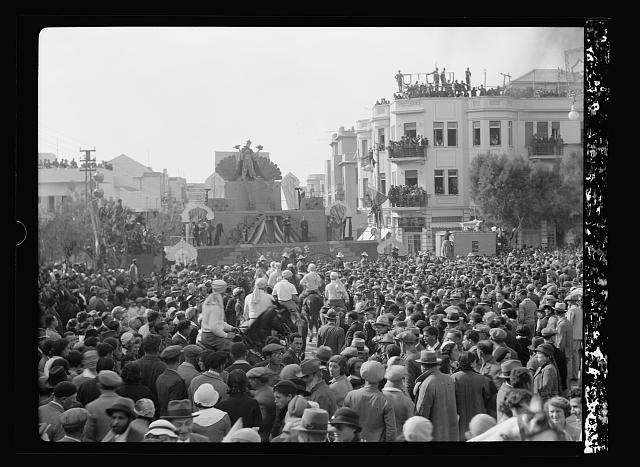 Purim Carnival in Tel Aviv. 1934. Purim celebration in Tel Aviv. Crowds in front of a temporary stage in the city square