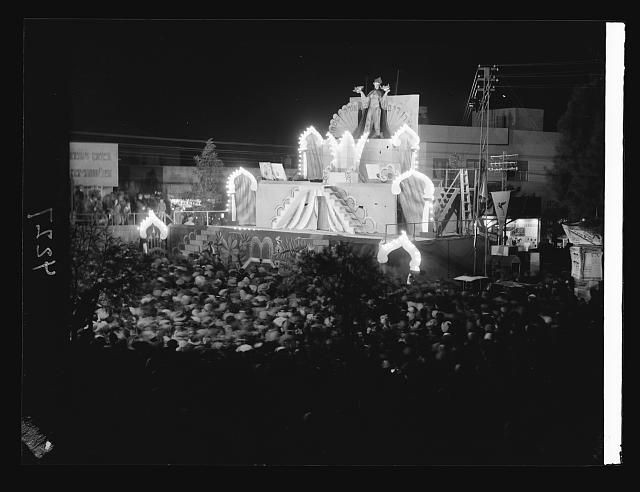 Purim Carnival in Tel Aviv. 1934. Purim celebration in Tel Aviv. Night picture of crowds in city square