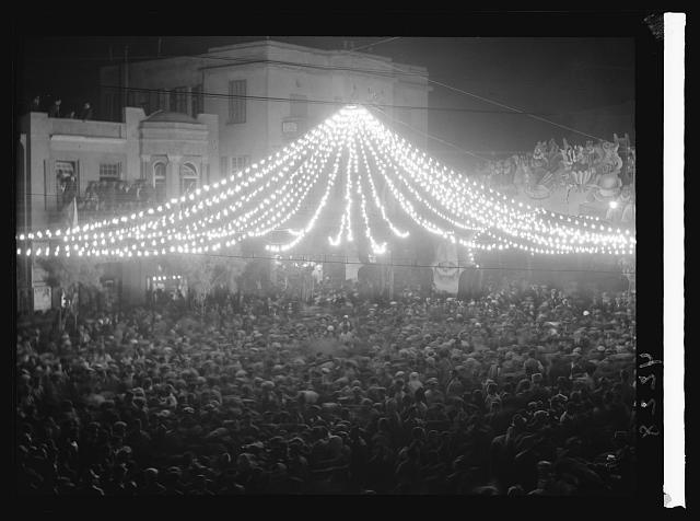 Purim Carnival in Tel Aviv. 1934. Purim celebration in Tel Aviv. Night crowds under a canopy of lights