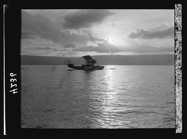 "Air views of Palestine. Aircrafts etc. of the Imperial Airways Ltd., on the Sea of Galilee and at Semakh. Flying boat ""Satyrus."" Sunrise silhouette"