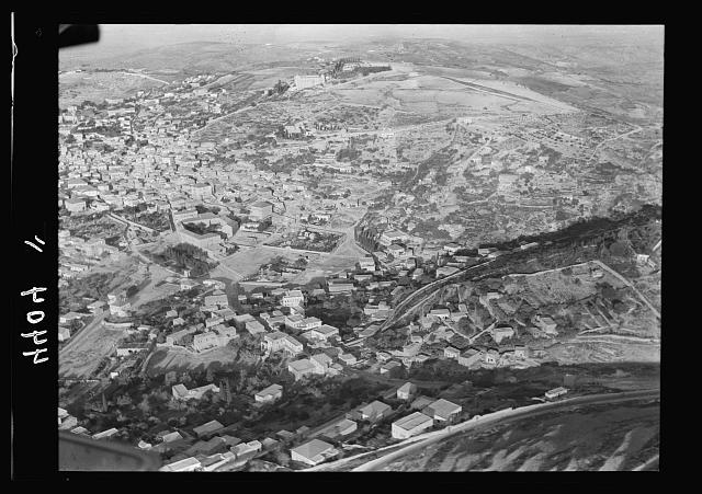 Air views of Palestine. Air route over Cana of Galilee, Nazareth, Plain of Sharon, etc. Nazareth. Approaching town from N.E. Virgin's fount in center of picture