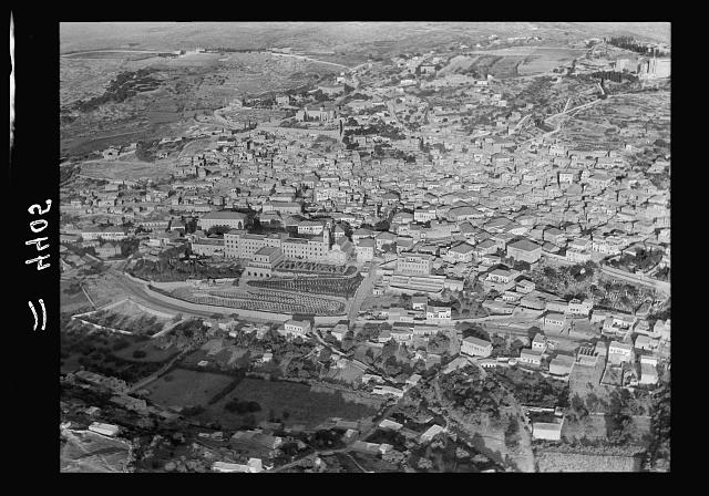 Air views of Palestine. Air route over Cana of Galilee, Nazareth, Plain of Sharon, etc. Nazareth. Approaching town from E. showing Franciscan monastery & Church of Annunciation