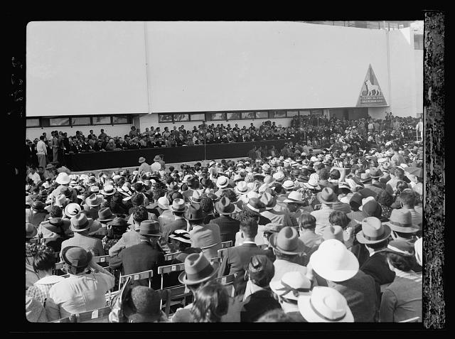 Opening of Levant Fair. Tel-Aviv Ap[ril] 30, 1936. Crowds seated for opening ceremony showing platform