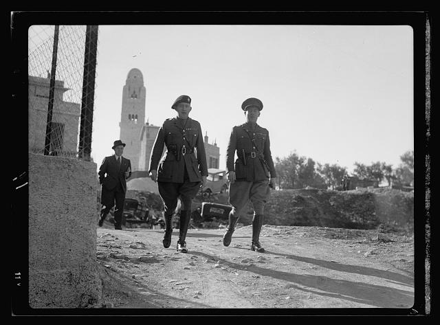 Judges of Jerusalem military court. Major A. Joyse (?) left & Major E. Catherall MBE. right, Warwickshire Regt. [i.e., Regiment]