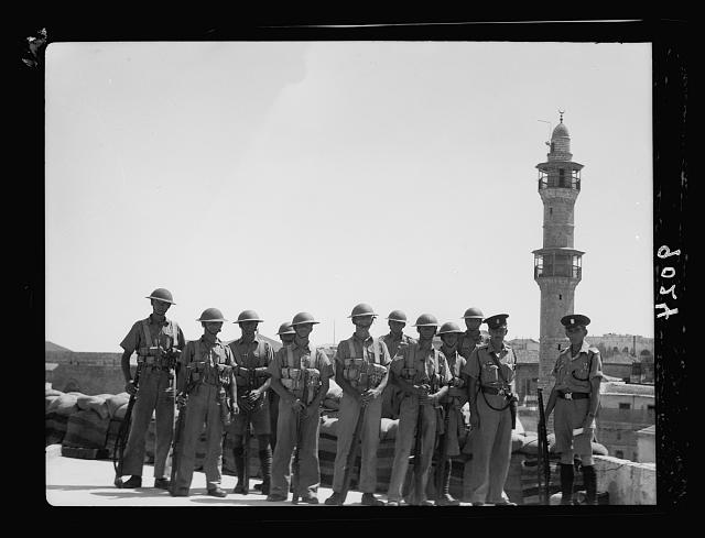 Palestine disturbances during summer 1936. Jaffa. Group of army & Palestine Police. Guards on a Jaffa house-top