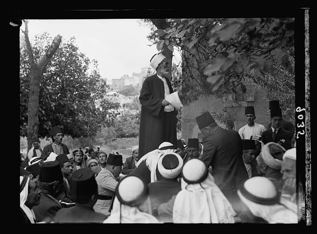 Palestine disturbances 1936. Moslem [i.e., Muslim] sheikh addressing large Arab gathering at Abou Ghosh