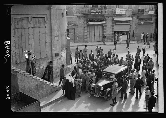 Palestine disturbances 1936. Body of a Hebronite shot in the Old City, being transported by car