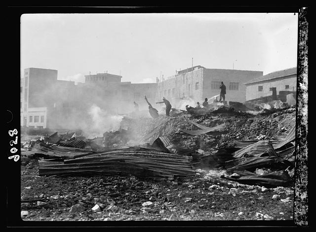 Palestine disturbances 1936. Incendiary of a Jewish lumber yard in the Shamma's Qt. [i.e., Quarter]