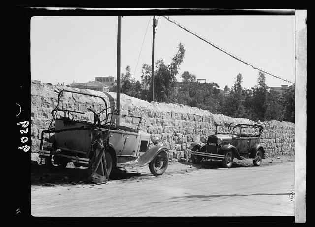 Palestine disturbances 1936. Two motor cars burnt on the highway, owners Jews