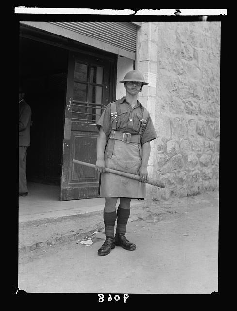 Palestine disturbances 1936. Soldiers with club guarding at the post office