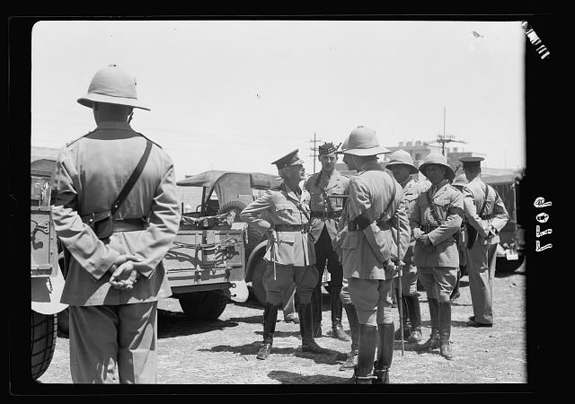 Palestine disturbances 1936. H.E. (i.e., His Excellency) The High Commissioner talking to officers of the 8th Hussars