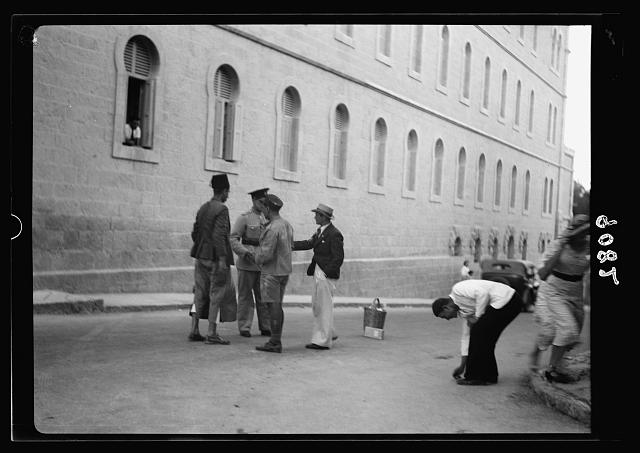 Palestine disturbances 1936. Nail picking on a Jerusalem Street, citizens ordered