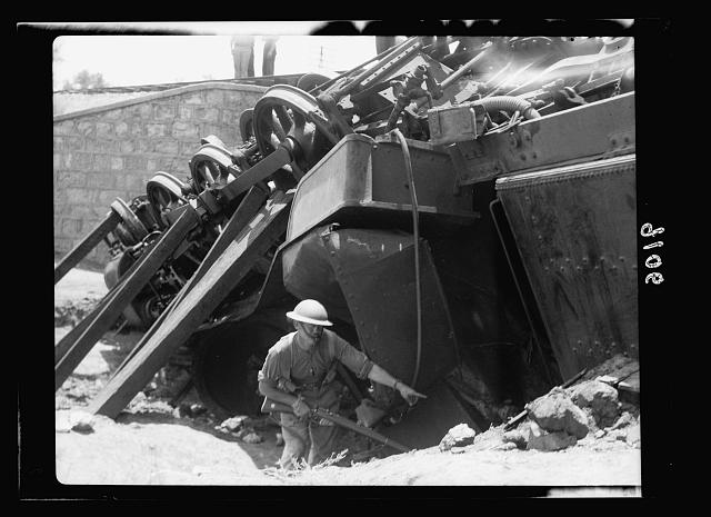 Palestine disturbances 1936. L/C Davidson showing where his comrade was pinned under the locomotive [near Kefr-Jenuis]