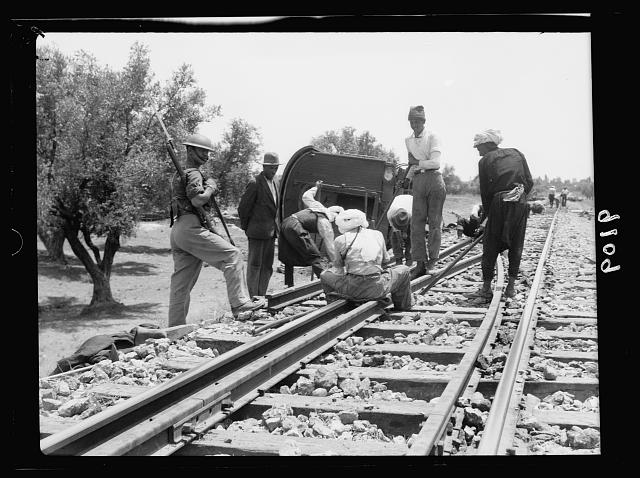 Palestine disturbances 1936. Railroad tracks being repaired under military guard [near Kefr-Jenuis?]