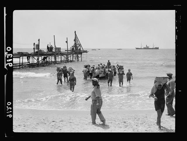 Palestine disturbances 1936. Jewish shore-men unloading cement at the Tel-Aviv jetty