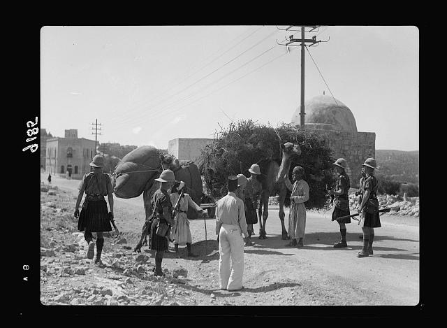 Palestine disturbances 1936. Scotch [i.e., Scots] soldiers stopping Arab camel-men in search for arms, near Rachel's Tomb on Bethlehem road