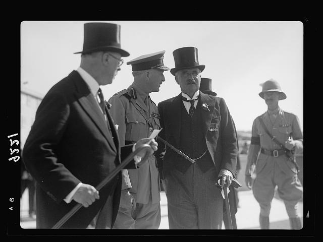 Palestine disturbances 1936. Members of the Royal Commission leaving the War Graves Cemetry [i.e., Cemetery]. Rt. Hon. Sir Horace Rumbold (left) Lord Peel (right) [Mount Scopus]