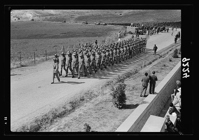 Palestine disturbances 1936. Military troop leaving the War Graves Cemetry [i.e., Cemetery] after service on Armistice Day [Mount Scopus]