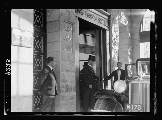 Palestine disturbances 1936. Earl Peel entering his car from main entrance of King David Hotel for his official drive to the Government House for the opening ceremony